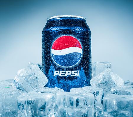 MOSCOW, RUSSIA-APRIL 4, 2014: Can of Pepsi cola on ice. Pepsi is a carbonated soft drink that is produced and manufactured by PepsiCo. Created and developed in 1893. Stock Photo - 28360824