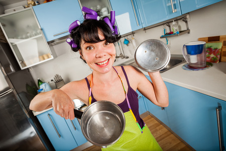 Crazy funny housewife in an interior of the kitchen photo