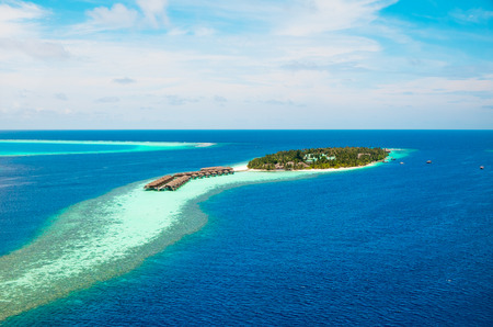 Hotel on the island birds-eye view. Maldives Indian Ocean photo