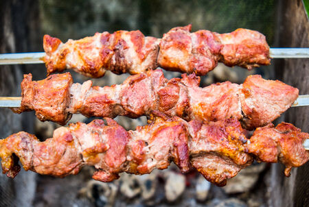 shish kebab: Shish kebab on metal skewers outdoor picnic Stock Photo