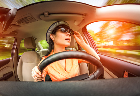 inattentive: Women behind the wheel of a car, not stares on the road creating an emergency situation.