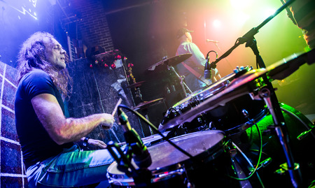 music stage: Musician playing drums on stage, rock music concert