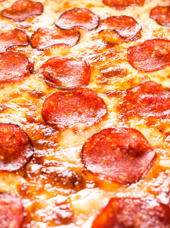 pepperoni pizza: Appetizing background pepperoni pizza closeup filling the frame. Stock Photo