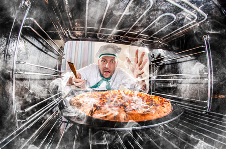 grates: Funny chef overlooked pizza in the oven, so she had scorched, view from the inside of the oven. Cook perplexed and angry. Loser is destiny!