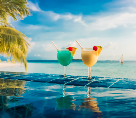 pool bars: Cocktail near the swimming pool on the background of the Indian Ocean, Maldives.