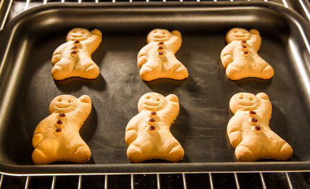 baking oven: Baking Gingerbread man in the oven. Cooking in the oven.