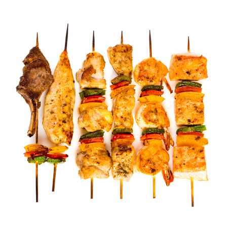 shish: Tasty grilled meat on a white background, shish kebab Stock Photo