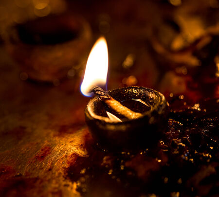 Burning candles in the Indian temple. Diwali – the festival of lights. photo