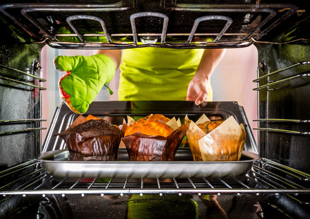 baking oven: Baking muffins in the oven, view from the inside of the oven Stock Photo