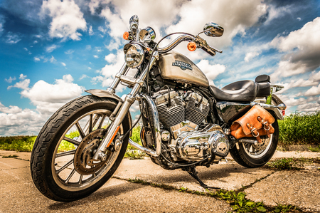 postproduction: RUSSIA-JULY 7, 2013: Harley-Davidson Sportster 883 Low. Harley-Davidson sustains a large brand community which keeps active through clubs, events, and a museum. Filter applied in post-production.