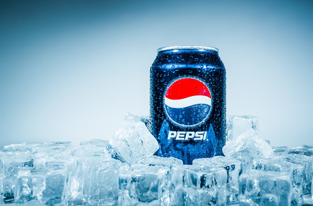 cola: MOSCOW, RUSSIA-APRIL 4, 2014: Can of Pepsi cola on ice. Pepsi is a carbonated soft drink that is produced and manufactured by PepsiCo. Created and developed in 1893.