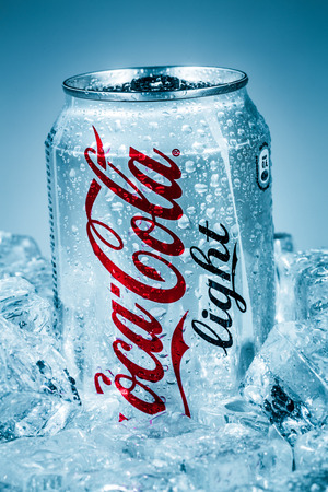 famous industries: MOSCOW, RUSSIA-APRIL 4, 2014: Can of Coca-Cola Lignt on ice. Coca-Cola is a carbonated soft drink sold in stores, restaurants, and vending machines throughout the world.