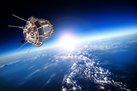 orbiting: Space satellite orbiting the earth Stock Photo