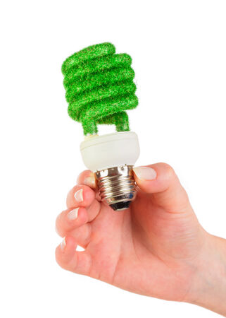 Eco light bulb in hand isolated on white background photo