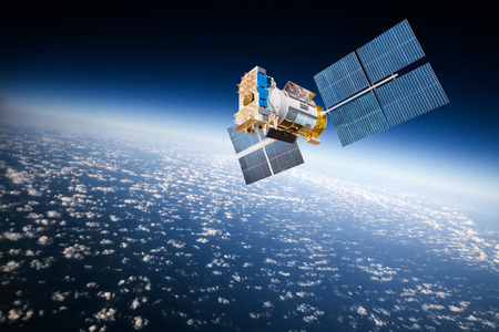 Space satellite orbiting the earth Stockfoto