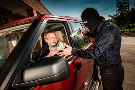 stealing money: Robbery of the businessman in its car Stock Photo