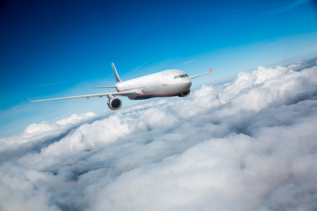 turbulence: Passenger Airliner flying in the clouds