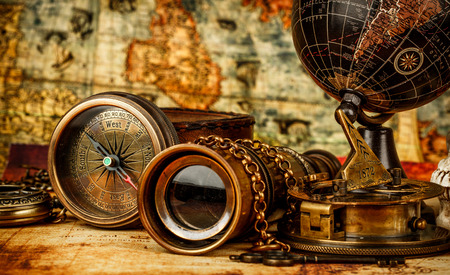 telescope: Vintage grunge still life. Vintage items on ancient map. Stock Photo
