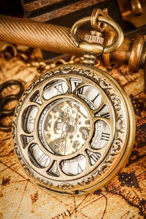 gold watch: Vintage Antique pocket watch. Vintage grunge still life.