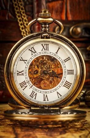 pocketwatch: Vintage Antique pocket watch. Vintage grunge still life.
