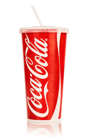 cola: MOSCOW, RUSSIA-October 6, 2014: Paper cups of Coca-Cola. Coca-Cola is a carbonated soft drink sold in stores, restaurants, and vending machines throughout the world.