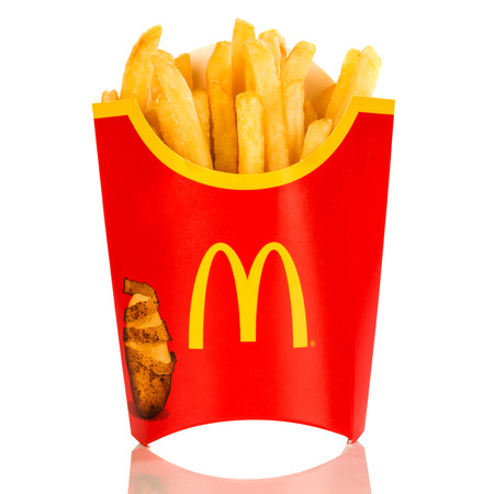 mcdonalds: MOSCOW, RUSSIA-JULY 7, 2013: McDonalds French fries. Corporation is the worlds largest chain of hamburger fast food restaurants, serving around 68 million customers daily in 119 countries Editorial