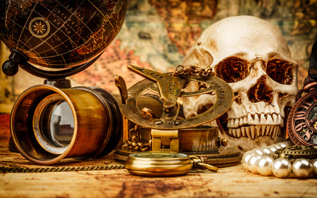 antiquity: Vintage grunge still life. Vintage items on ancient map. Stock Photo