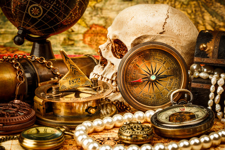 Vintage grunge still life. Vintage items on ancient map. photo