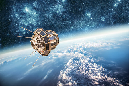 space ship: Space satellite orbiting the earth. Elements of this image furnished by NASA. Stock Photo