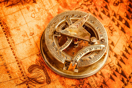 Vintage still life. Vintage compass lies on an ancient world map in 1565. photo