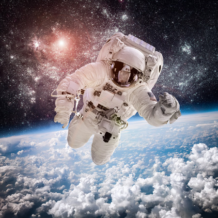 astronaut in space: Astronaut in outer space against the backdrop of the planet earth. Elements of this image furnished by NASA. Stock Photo