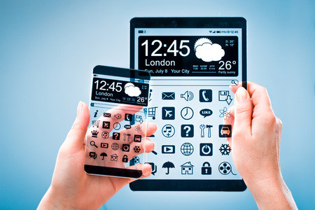 Smart phone (phablet) and tablet with a transparent display in human hands. Concept actual future innovative ideas and best technologies humanity. photo