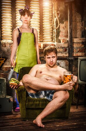 pauperism: Family Life. Portrait of husband and wife in a poor slums room.