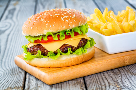 hamburger and fries: Tasty and appetizing hamburger cheeseburger Stock Photo