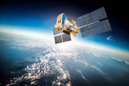 telecommunication equipment: Space satellite orbiting the earth.  Stock Photo