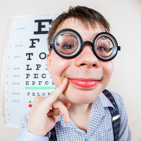 oculist: Person wearing spectacles in an office at the doctor Stock Photo