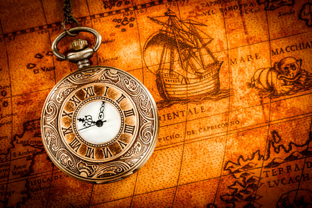 pocketwatch: Vintage Antique pocket watch on an ancient world map in 1565..