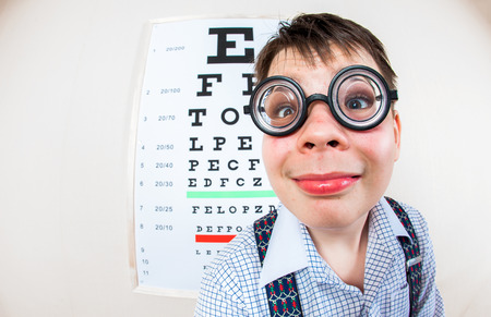 diopter: Person wearing spectacles in an office at the doctor Stock Photo
