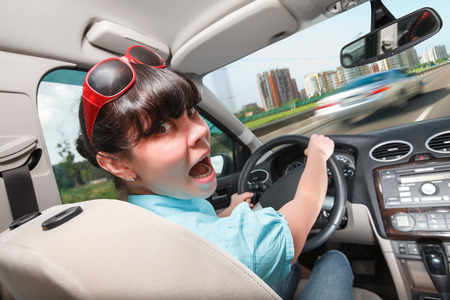 drive: Woman in panic behind the wheel of the car. Driving lessons The woman behind the wheel..