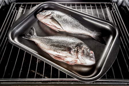 grates: Dorado fish Cooking in the oven.