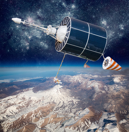 orbital spacecraft: Space satellite orbiting the earth. Elements of this image furnished by NASA. Stock Photo