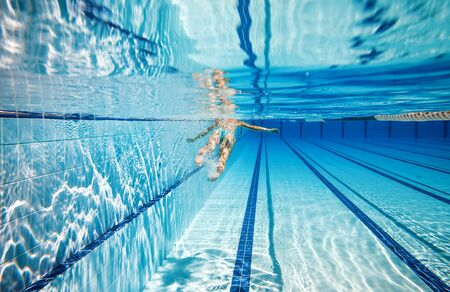 swimming competition: woman swimming in the poolin the pool under water