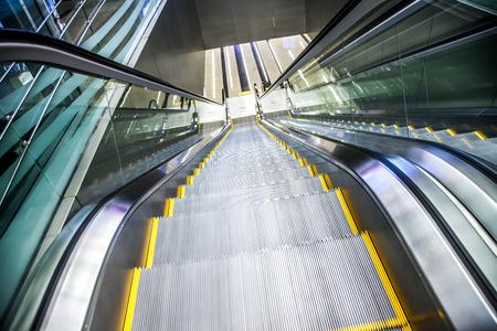 elevated walkway: Airport moving sidewalk also travelator, walkalator and movator.