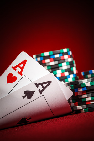 poker cards: Stack of chips and two aces
