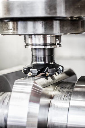 milling: Metalworking CNC milling machine. Cutting metal modern processing technology. Small depth of field. Warning - authentic shooting in challenging conditions. A little bit grain and maybe blurred.