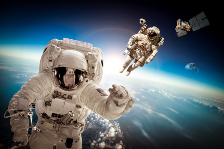 space travel: Astronaut in outer space against the backdrop of the planet earth. Elements of this image furnished by NASA. Stock Photo