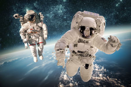 cosmonaut: Astronaut in outer space against the backdrop of the planet earth. Elements of this image furnished by NASA. Stock Photo