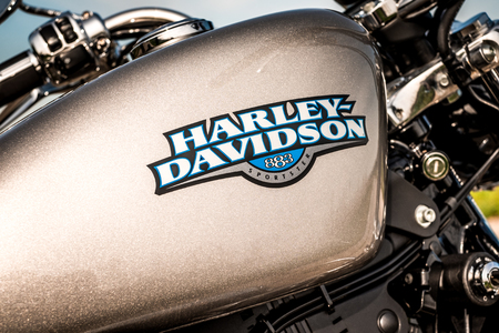 postproduction: RUSSIA-JULY 7, 2013: Harley-Davidson gas tank Sportster 883. Harley-Davidson sustains a large brand community which keeps active through clubs, events, and a museum. Filter applied in post-production.