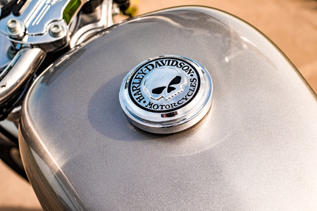 sportster: RUSSIA-JULY 7, 2013: Harley-Davidson gas tank Sportster 883. Harley-Davidson sustains a large brand community which keeps active through clubs, events, and a museum. Filter applied in post-production.