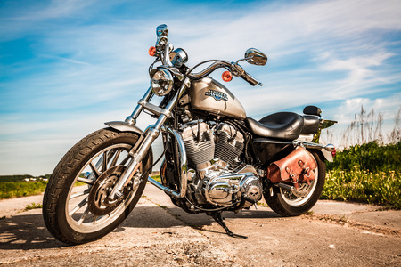 sportster: RUSSIA-JULY 7, 2013: Harley-Davidson Sportster 883 Low. Harley-Davidson sustains a large brand community which keeps active through clubs, events, and a museum. Filter applied in post-production.